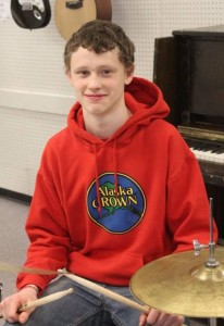 Aidan, the alert drummer, leads the group with his reliable rhythms. No song is too tough for him; he studies it and works it out, then plays so confidently he makes it look easy.