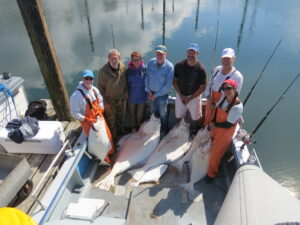 Dale and Paul, fishing with Seldovia Fishing Adventures bring in 180 and 115 pound halibut!