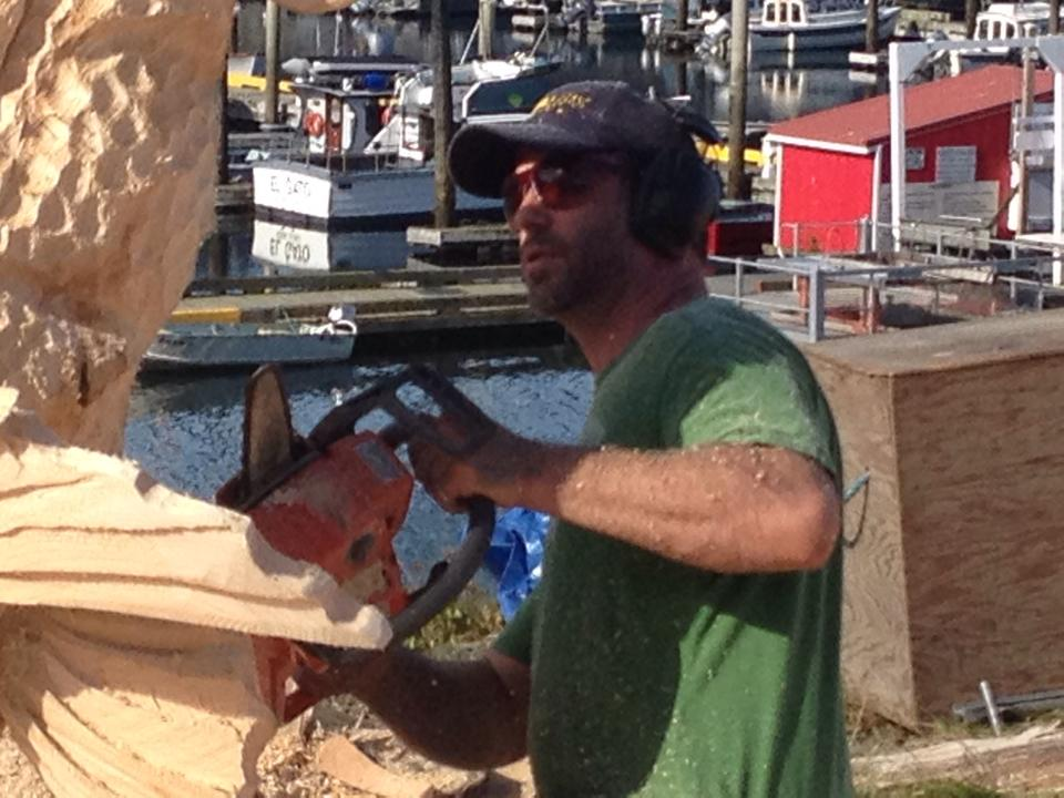 Chris carving the details on his yellow eye fish.  Photo by Liane Crosta